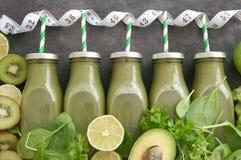 Green vegetable smoothies stock photos