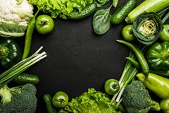 Green Vegetables Arranged On The Black Table, Space For Writing Royalty Free Stock Photography