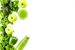 Green vegetables background with vegetable smoothies. Shiny bell pepper, cucumber, arugula salad, avocado and fresh royalty free stock photo
