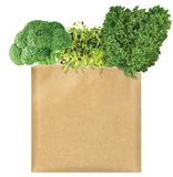 Green Vegetables in a brown paper bag royalty free stock photography