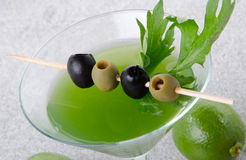 Green vegetables cocktail on a sand background Stock Photo