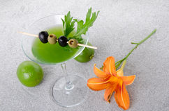 Green vegetables cocktail on a sand background Royalty Free Stock Photography