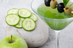 Green vegetables cocktail on a sand background Stock Photography
