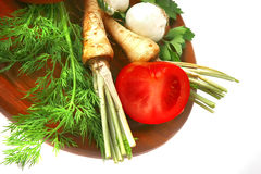 Green vegetables on cut plate Royalty Free Stock Photos