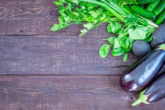 Green Vegetables and Fresh Herbs for Healthy Cooking on Vintage Wooden Table, Diet or Vegetarian Food Concept, Background Layout w Royalty Free Stock Photo