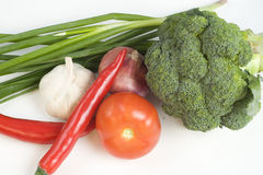 Green vegetables and fruit. Green produce - garlic, onion, chili, tomato, broccoli and shallot Stock Images