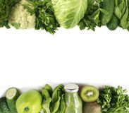 Green vegetables. Green fruit and vegetable on white background. Apples, parsley, spinach, cucumber and kiwi on a white background. Top view. Spinach smoothie stock image