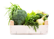Green vegetables and fruit in wooden box Royalty Free Stock Photo