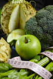 Green vegetables and fruits -  celeriac, broccoli, celery shoots Stock Photos