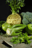 Green vegetables and fruits -  celery, apples, celery root celery Royalty Free Stock Photo
