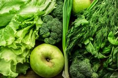 Green vegetables, fruits and greenery food background. Top view royalty free stock photos