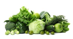 Green vegetables and fruits on white background. Food photography Royalty Free Stock Photos