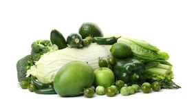 Green vegetables and fruits on white background. Food photography Royalty Free Stock Images