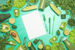 Green vegetables with a note book for the inscription. To prepare a healthy and healthy meal. Healthy green vegan cooking royalty free stock photos