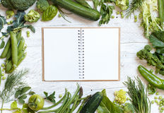 Green vegetables with notebook on a wooden table Stock Photos