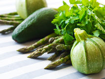 Green vegetables on table cloth. Green vegetables on striped table cloth Royalty Free Stock Image