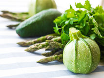Green vegetables on table cloth. Green vegetables on striped table cloth Stock Image