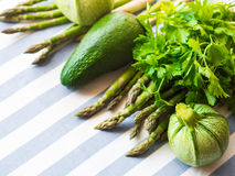 Green vegetables on table cloth. Green vegetables on striped table cloth Stock Photography
