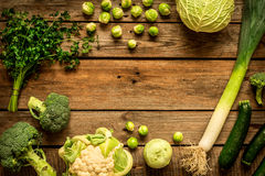 Green vegetables on vintage rustic wooden background royalty free stock image