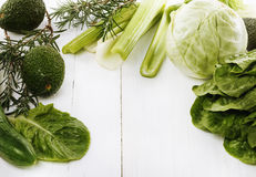 Green vegetables on a white wooden background Royalty Free Stock Photography