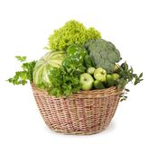 Green vegetables in wicker basket Stock Images