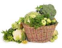 Green vegetables in wicker basket Stock Photos