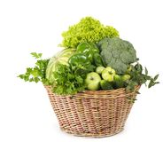 Green vegetables in wicker basket Stock Image