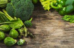 Green vegetables on a wooden background. Healthy food. Copy space Stock Photo