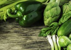 Green vegetables on a wooden background. Healthy food. Copy space Stock Photography