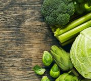 Green vegetables on a wooden background. Healthy food. Top view, copy space Stock Photo