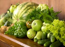 Green vegetables a wooden background Royalty Free Stock Image