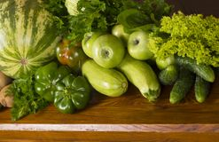 Green vegetables a wooden background Stock Photo