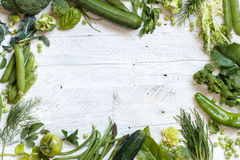 Green vegetables on a wooden table Royalty Free Stock Image