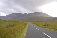 Green Vegetation and Mountain Landscape in a National Road in Ireland Stock Image