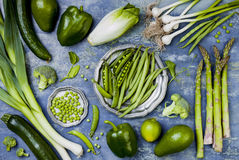Green veggies group. Vegetarian dinner ingredients. Green vegetables variety. Overhead, flat lay, top view, Royalty Free Stock Photo
