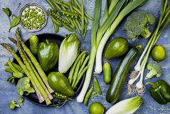 Green veggies group. Vegetarian dinner ingredients. Green vegetables variety. Overhead, flat lay, top view. stock image