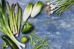 Green veggies group. Vegetarian dinner ingredients. Green vegetables variety. Overhead, flat lay, top view, copy space. Green veggies group. Vegetarian dinner stock photography