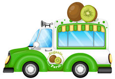 A green vehicle selling kiwi fruits Royalty Free Stock Photos