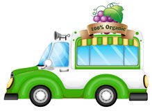A green vehicle selling organic fruits Royalty Free Stock Photo