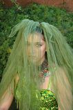 Green Veiled Girl. Mysteriously saddened girl with a green veil covering her face Stock Photo