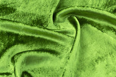 Green velvet close-up. Fabric macro for texture and background. Green silk velvet close-up. Fabric macro for texture and background Stock Photos