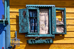 Green venetian blind and a yellow wall    la boca buenos aires a Stock Photography