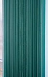 Green vertical textile window blinds. Royalty Free Stock Image