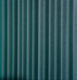 Green vertical textile window blinds. Royalty Free Stock Photography