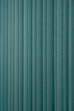 Green vertical textile window blinds. Stock Photo