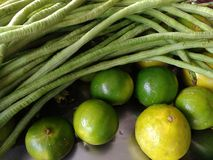 Green vetgetable. Oraganic green vetgetable and lamon and lime Royalty Free Stock Images