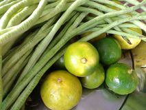 Green vetgetable. Oraganic green vetgetable and lamon and lime Royalty Free Stock Photography