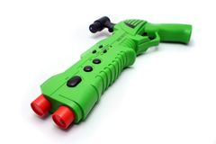 Green Video Game Gun Controller on White. Isolated Green Wireless Video Game Gun Controller Royalty Free Stock Photography
