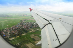 Green view from the airplane window. Green field view from the airplane window stock photo