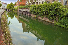 Green view of the canal of old part in Bruges. Royalty Free Stock Photography